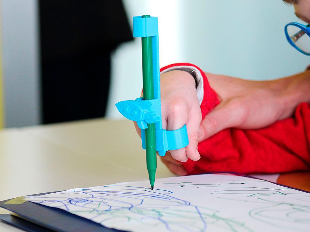 Glifo, herramientas de diseño y escritura para niños con discapacidad motora